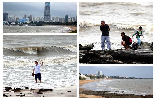 """受台风""""山神""""影响海口海域有风浪 游客冒险玩海"""